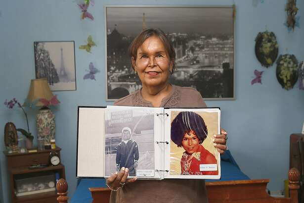 Felicia Elizondo shows her photo album where she was in Coronado in the navy during the sixties at home on Friday, June 17, 2016 in San Francisco, Calif.