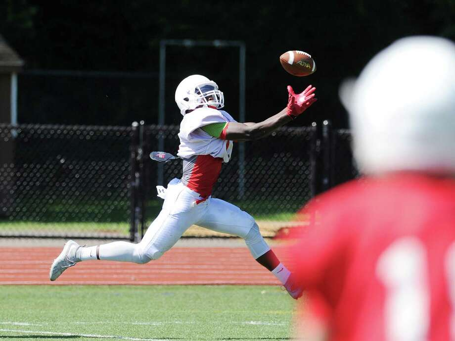 Receiver James Day of the white team makes a first quarter catch for a touchdown on a pass from quarterback Connor Langan during the annual 2016 Greenwich High School spring Red & White football game at the school in Greenwich, Conn., Saturday, June 18, 2016. Photo: Bob Luckey Jr. / Hearst Connecticut Media / Greenwich Time