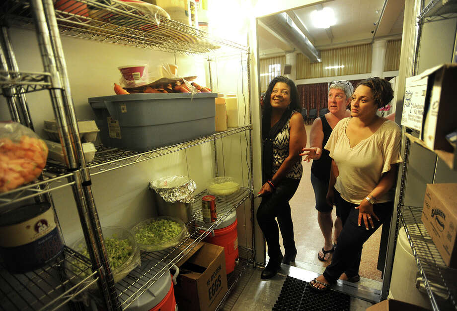 Entrepreneurs Debbie Green, of Stratford, left, and Raquel Rivera-Pablo, of Bridgeport, are shown the commercial refrigerator by kitchen manager Heidi Vanderwal at United Congregational Church in Bridgeport on Wednesday, The Council of Churches of Greater Bridgeport is seeking to amend zoning laws to allow churches to rent their kitchens for use by start up businesses. Photo: Brian A. Pounds / Hearst Connecticut Media / Connecticut Post