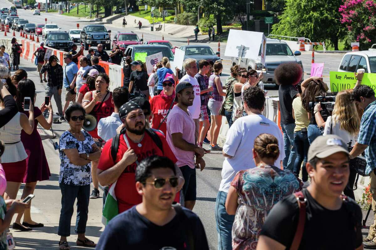San Antonio, Texas -- June 17, 2016 -- People protesting Republican presidential candidate Donald Trump's visit to San Antonio gathered near his private fundraiser at Oak Hills Country Club. Ray Whitehouse/for the San Antonio Express-News
