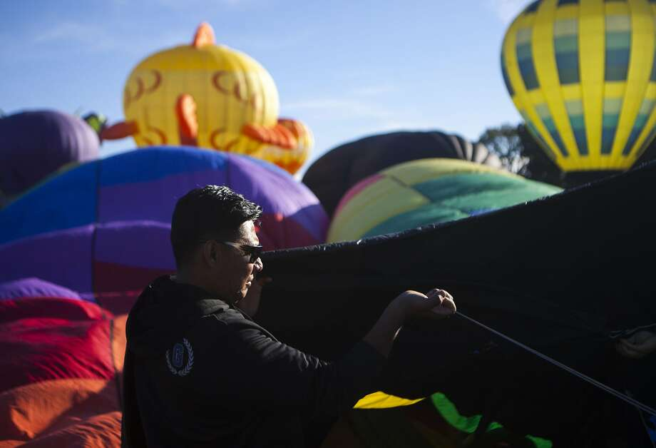 Alberto Rodriguez helps support Shadowdancer II as it begins the cold packing process during the Sonoma 26th Air Balloon Classic on Saturday, June 18, 2016 in Windsor, California. Photo: Michael Noble Jr., The Chronicle
