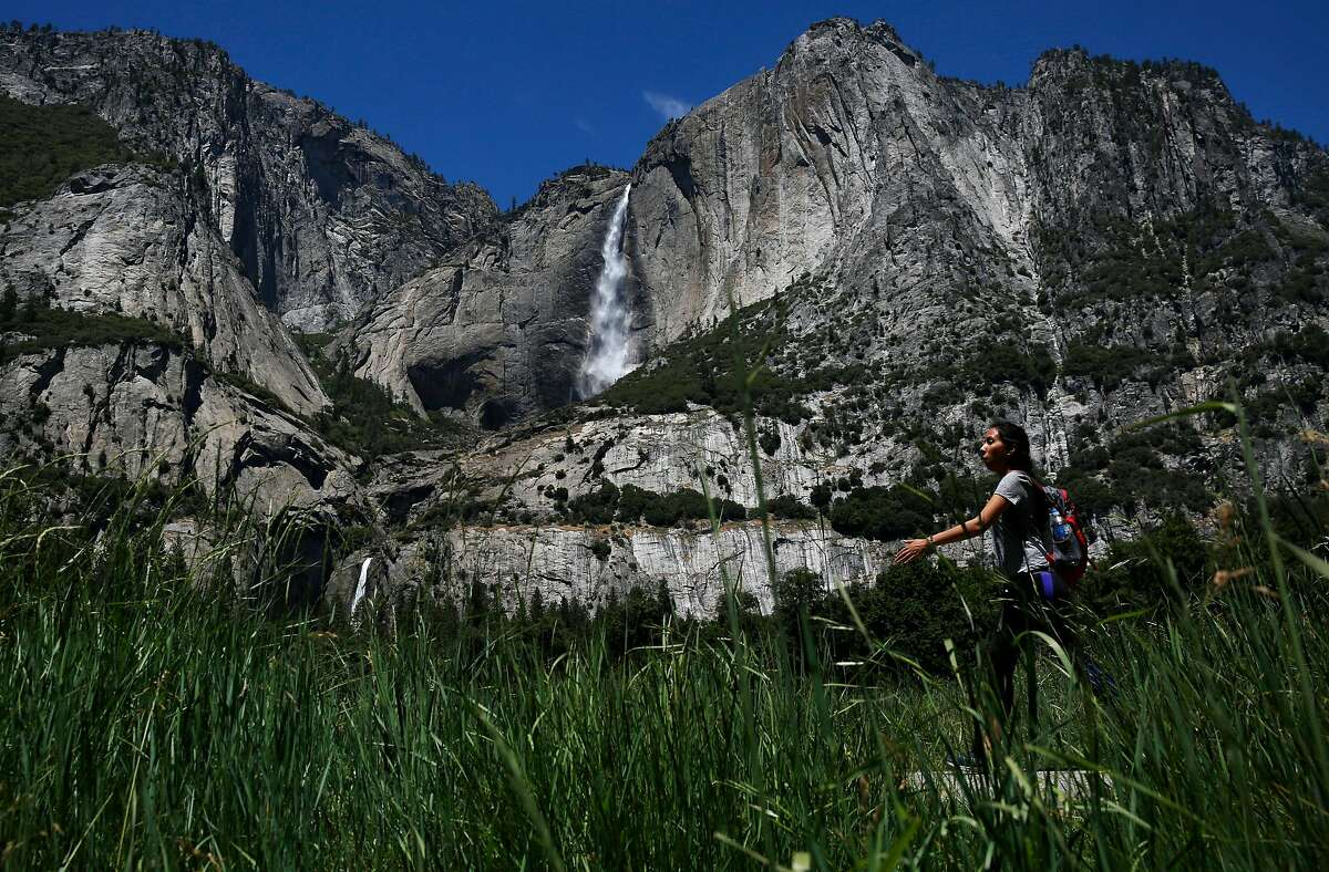 Slightly diminished Yosemite Falls are visible from Cook's Meadow at Yosemite National Park June 18, 2016 in Yosemite Valley, Calif.