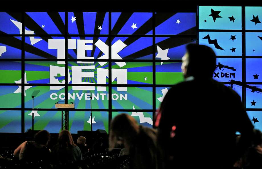 Texas Democratic delegates enter the main hall for the final day of the party's state convention at the Alamodome on Saturday, June 18, 2016. Delegates voted on platforms and resolutions and declared national delegates among the handful of items on their agenda. (Kin Man Hui/San Antonio Express-News) Photo: Kin Man Hui, Staff / San Antonio Express-News / ©2016 San Antonio Express-News