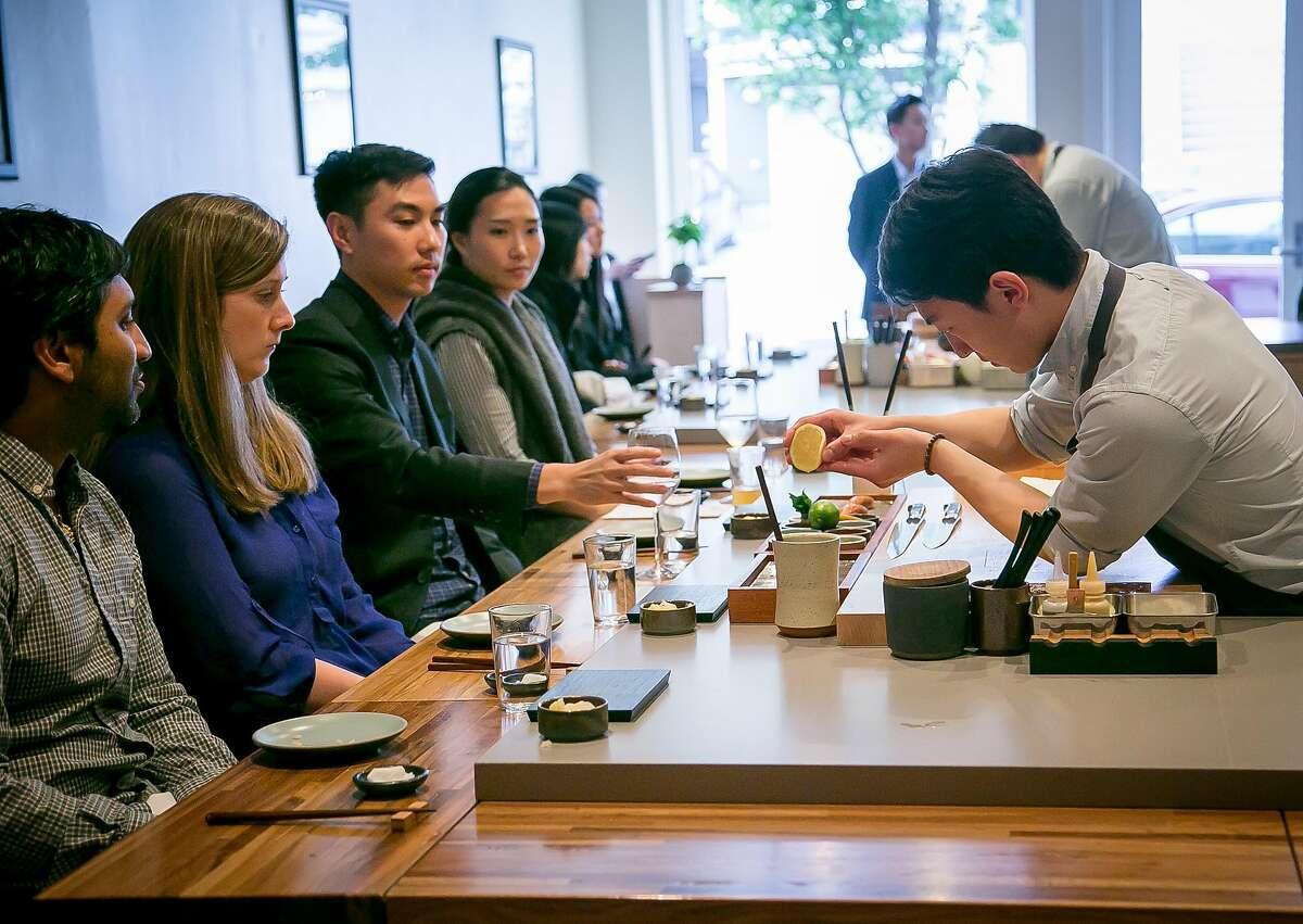 Sushi chef Steve Kim makes sushi for customers at Ju Ni in San Francisco, California, on June 17th, 2016.