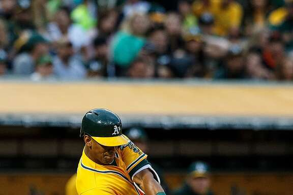 OAKLAND, CA - JUNE 17:  Khris Davis #2 of the Oakland Athletics hits a home run against the Los Angeles Angels of Anaheim during the fourth inning at the Oakland Coliseum on June 17, 2016 in Oakland, California. The Oakland Athletics defeated the Los Angeles Angels of Anaheim 3-2. (Photo by Jason O. Watson/Getty Images)