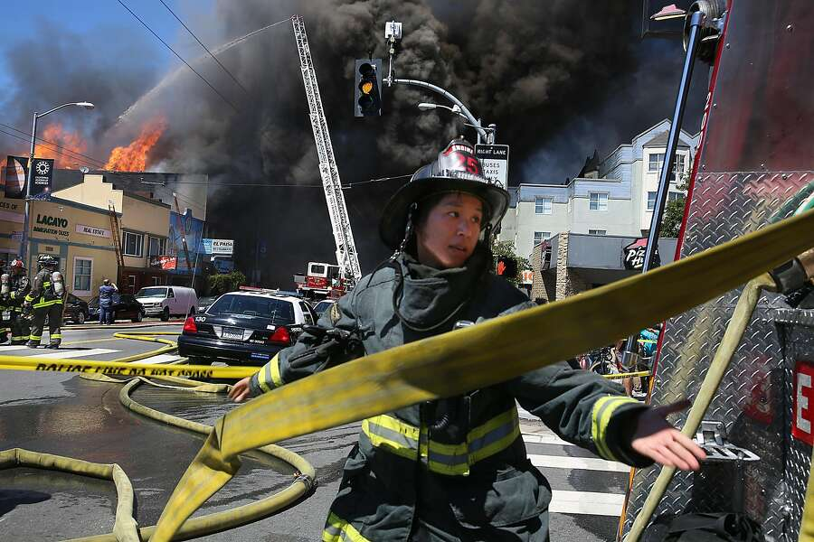 Firefighters battle a three alarm fire at 3312 Mission St. on Saturday, June 18, 2016 in San Francisco, Calif. Photo: Liz Hafalia, The Chronicle