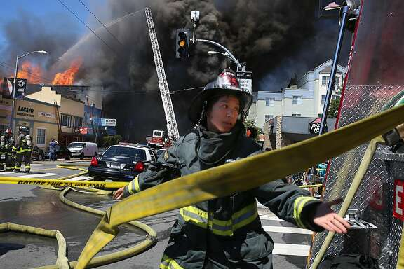 Firefighters battle a three alarm fire at 3312 Mission St. on Saturday, June 18, 2016 in San Francisco, Calif.