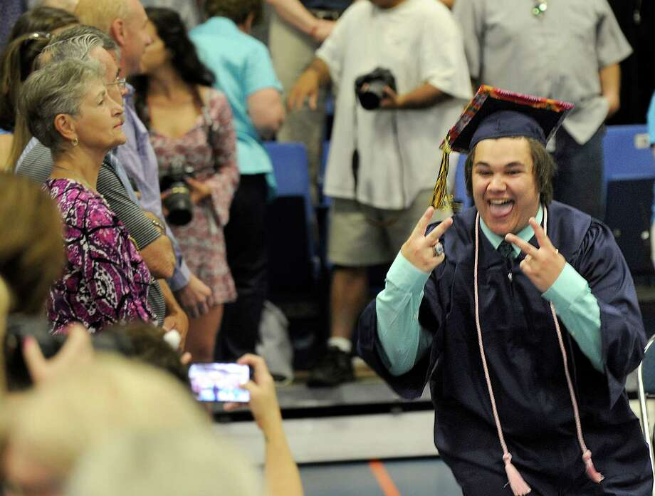Ian Townley gestures as he enters the O'Neill Center at the start of Brookfield's graduation Saturday. Brookfield High School holds its graduation ceremony Saturday, June 18, 2016, at the O'Neill Center at Western Connecticut State Universaity in Danbury. Photo: Carol Kaliff, Hearst Connecticut Media / The News-Times