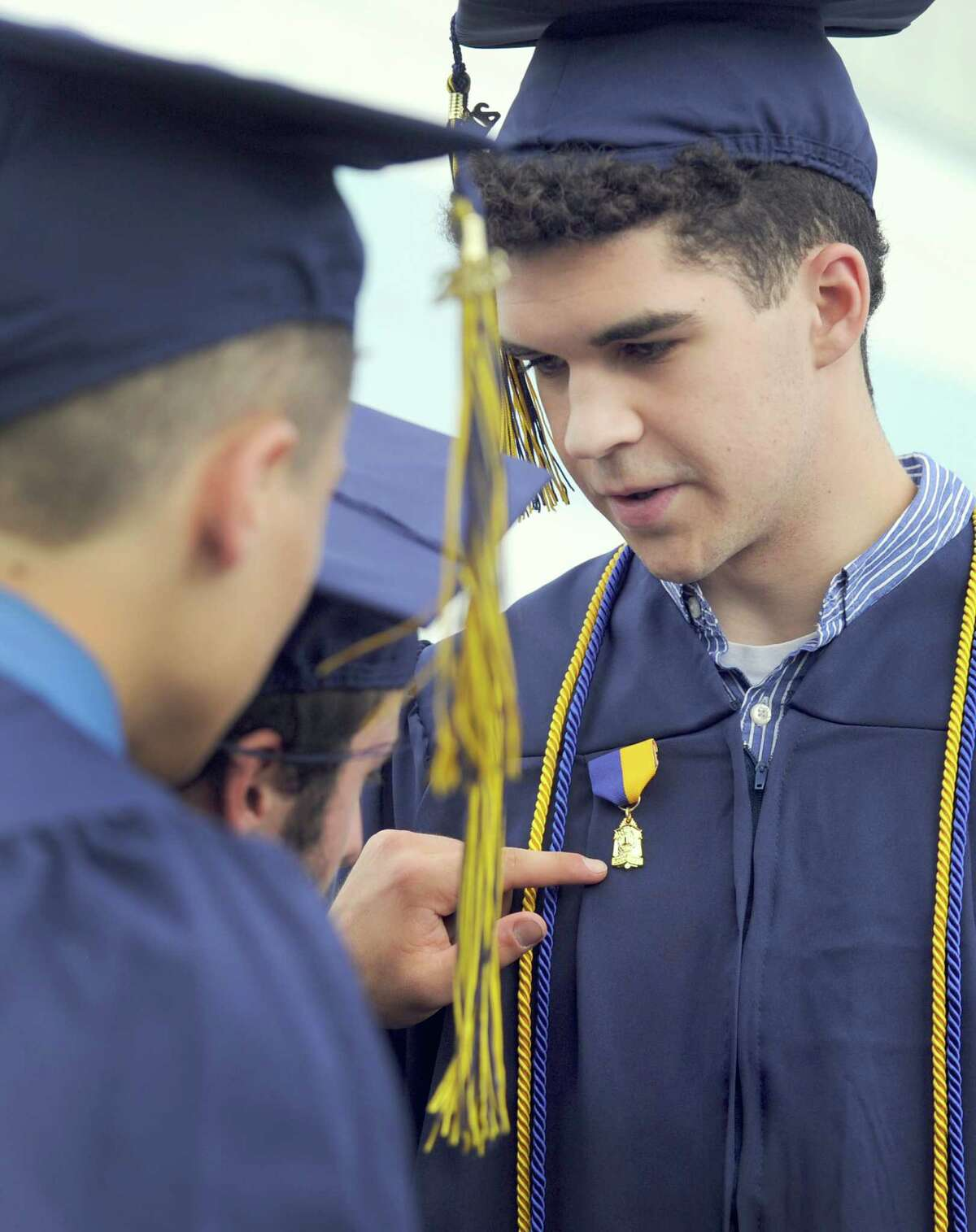 Nick Lopez, 17, shows his friends his World Lanquage Department Medal before the start of graduation Saturday. Brookfield High School holds its graduation ceremony Saturday, June 18, 2016, at the O'Neill Center at Western Connecticut State Universaity in Danbury.