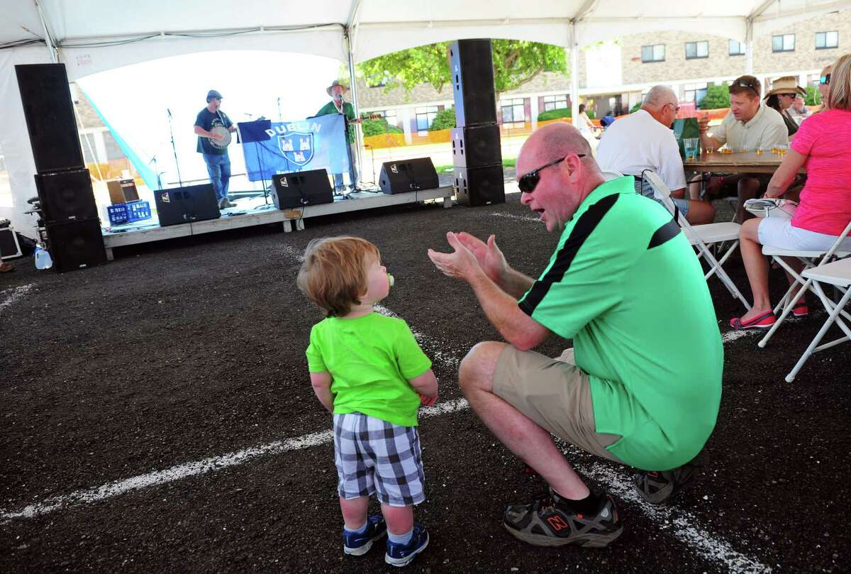 Mark Egan tries to get his son Gavin 1, to clap along with the band Camac, during the Fairfield Couty Irish Festival at Fairfield University in Fairfield, Conn., on Saturday June 18, 2016. The event featured various bands like the Narrowback, the Fairfield Gaelic Pipe Band and the Highland Rovers Band among others. Participants were able to try authentic Irish cuisone, many brands of beer and kids were entertained as well with events like animals from the Critter Carivan and a scavenger hunt.