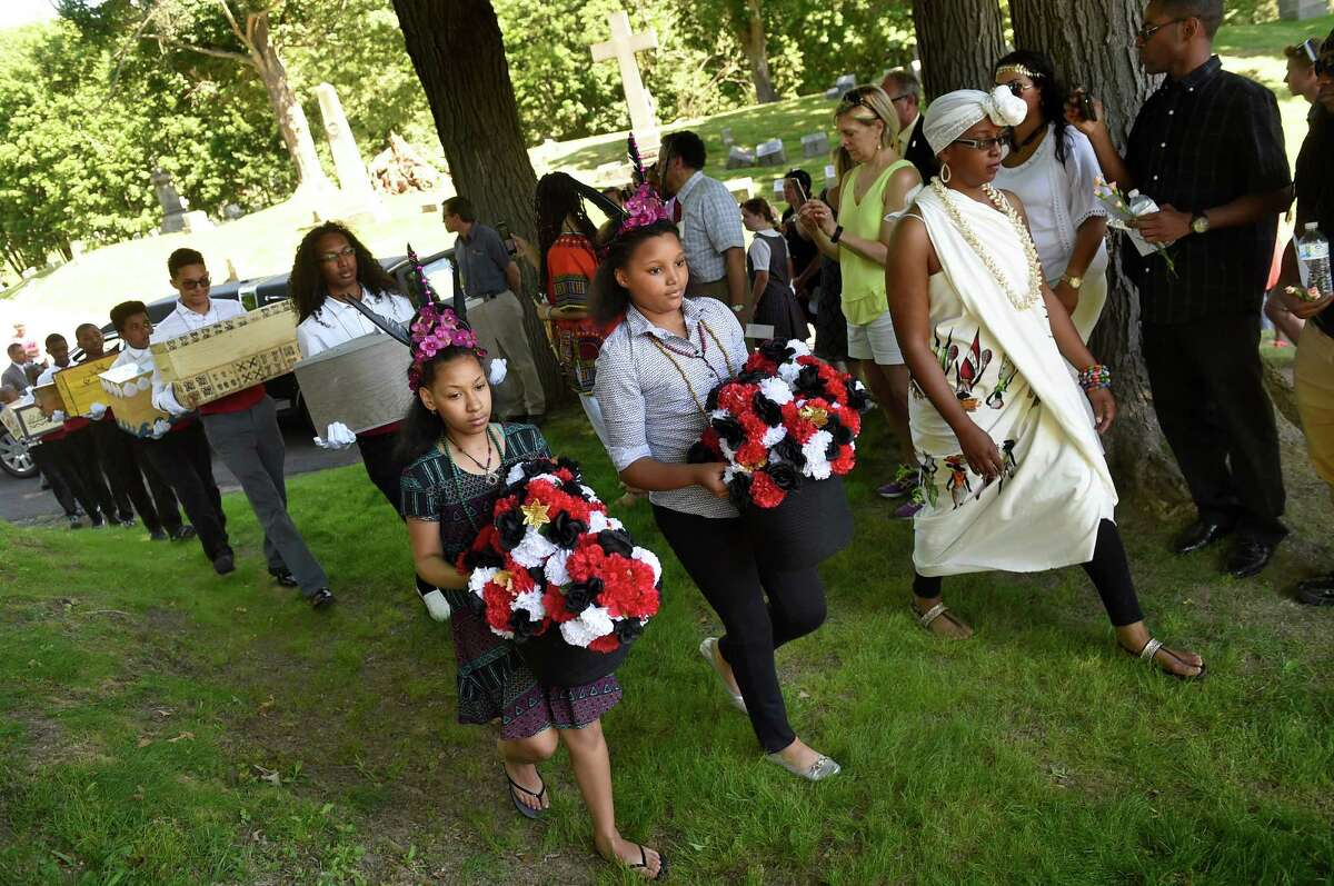 A procession of pallbearers carry ossuaries containing the remains of 14 people enslaved in life during the Schuyler Flatts Burial Ground Project service on Saturday, June 18, 2016, at St. Agnes Cemetery in Menands, N.Y. (Cindy Schultz / Times Union)