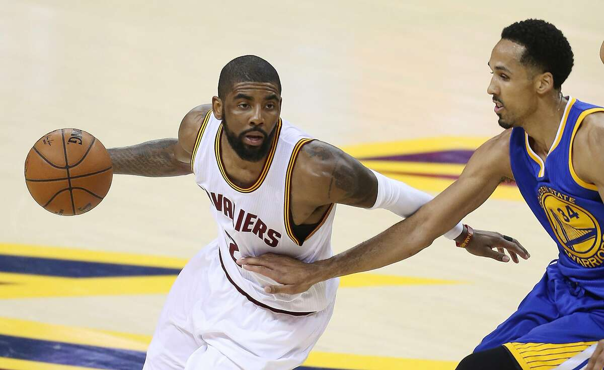 Cleveland Cavaliers guard Kyrie Irving (2) against Golden State Warriors guard Shaun Livingston (34) during the first half of Game 6 of basketball's NBA Finals in Cleveland, Thursday, June 16, 2016. (AP Photo/Ron Schwane)