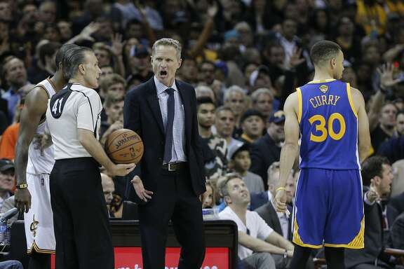 Golden State Warriors' Coach Steve Kerr argues a foul call against Stephen Curry in the fourth quarter during Game 6 of the NBA Finals at The Quicken Loans Arena on Thursday, June 16, 2016 in Cleveland, Ohio.