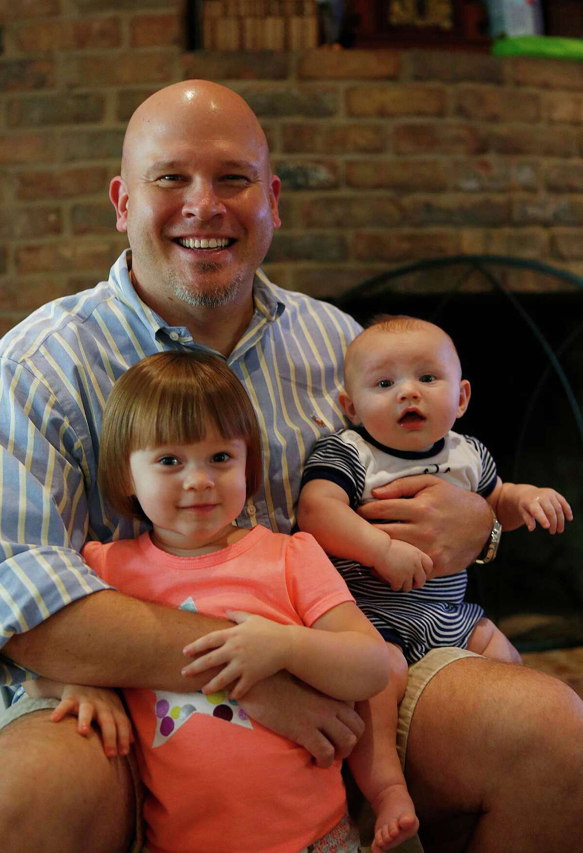 Jay Becraft decided to stay at home with his two children, Molly, 2, and Jay, Jr., 5-months, while his wife Elaine returned to work, Tuesday, Oct. 20, 2015, in Houston.