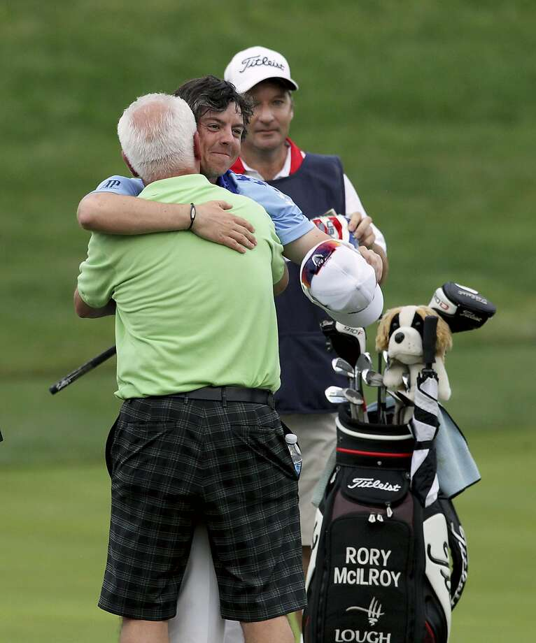 FILE -- Rory McIlroy hugs his father, Gerry, after winning the U.S. Open on Father's Day in Bethesda, Md., June 19, 2011. Several professional golfers at this year's event say their fathers played big, if not always welcome, roles in getting them into the sport, and now as parents themselves, they say golf and fatherhood are inexorably entwined. (Doug Mills/The New York Times) Photo: DOUG MILLS, NYT