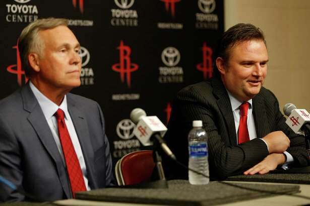 New Rockets coach Mike D'Antoni, left, and GM Daryl Morey hope to get lucky in Thursday's draft.