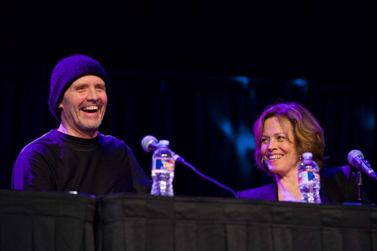 """""""Aliens"""" love still endures after decades Michael Biehn, left, and Sigourney Weaver speak at an """"Aliens"""" panelduring Comicpalooza, at the George R. Brown Convention Center, Saturday, June 18, 2016, in Houston. The cast's Saturday afternoon panel was heavily-attended and the stars were busy at their signing tables before and after."""