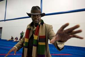 A fan dressed as the Fourth Doctor poses for a photo during Comicpalooza, at the George R. Brown Convention Center, Saturday, June 18, 2016, in Houston.