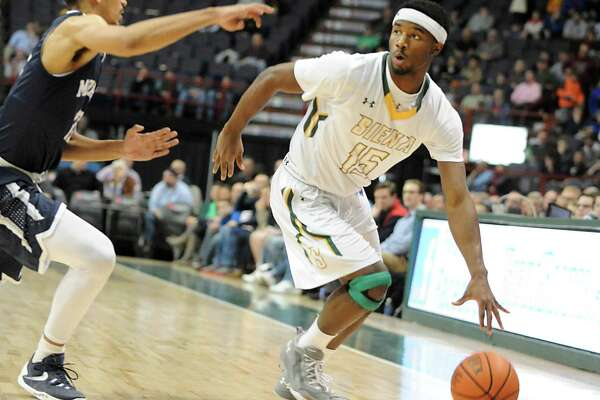 Siena's Nico Clareth dribbles the ball down the court during a basketball game against Monmouth at the Times Union Center on Monday, Feb. 1, 2016 in Albany, N.Y.  (Lori Van Buren / Times Union)