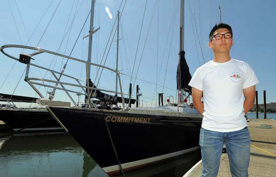 Midshipman Aaron Lee, a student at the United States Naval Academy on Friday, June 17, 2016 is photographed next to the Commitment, a Navy 44s sailing boat that is in port at the Stamford Yacht Club for the weekend. Lee is participating in the Offshore Sail Training Squadron (OSTS) program, one of the premier summer training programs for Midshipmen at the US Naval Academy. The Midshipmen receive training in ocean sailing, seamanship, navigation, leadership, and teamwork. Photo: Matthew Brown / Hearst Connecticut Media / Stamford Advocate