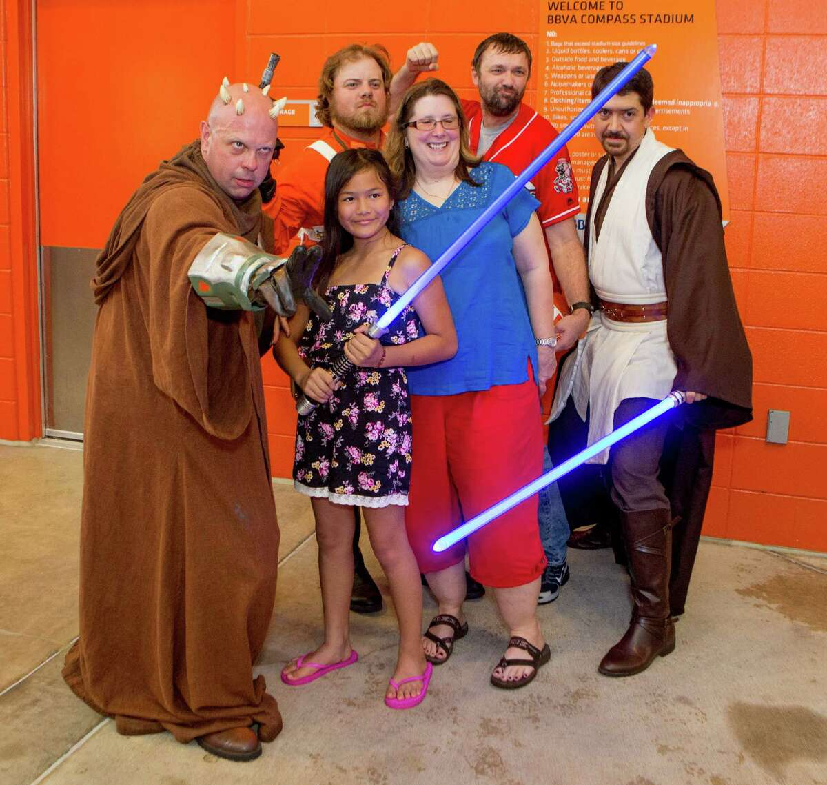 Soccer fans posing with Star Wars characters before the first half of action between the Houston Dynamo and the D.C. United during a soccer game at BBVA Compass, Saturday, June 18, 2016, in Houston. ( Juan DeLeon / for the Houston Chronicle )
