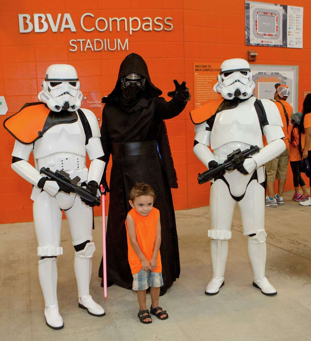 A young Start Wars fan posing with Star Wars characters before the first half of action between the Houston Dynamo and the D.C. United during a soccer game at BBVA Compass, Saturday, June 18, 2016, in Houston. ( Juan DeLeon / for the Houston Chronicle )