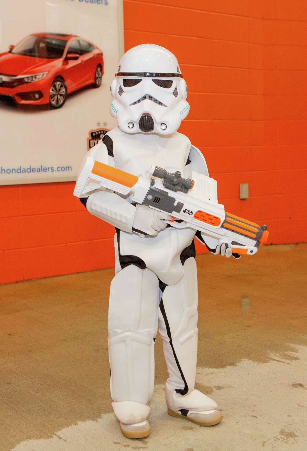 Julian Celesto in a Storm Trooper costume posing for a photo before the first half of action between the Houston Dynamo and the D.C. United during a soccer game at BBVA Compass, Saturday, June 18, 2016, in Houston. ( Juan DeLeon / for the Houston Chronicle )