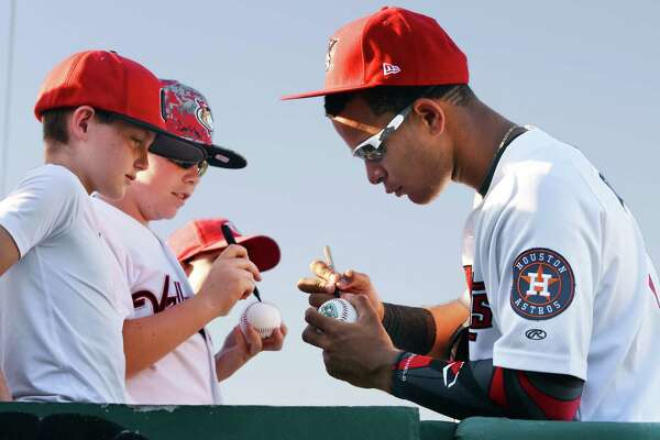 Garrett Cole,left, 12, and Nick Mahar, 12, both of Guilderland get an autograph from Tri-City ValleyCats' infielder Randy Cesar before Saturday's game against the Connecticut Tigers at Joe Bruno Stadium June 18, 2016 in Troy, NY.  (John Carl D'Annibale / Times Union)