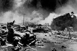 1947 - Texas City Disaster - The force of the SS Grandcamp explosion, coupled with flying debris produced by the blast, left this scene of destruction. A surge of water - a tidal wave - pushed from the harbor added to the damage. Jerry Maze / Houston Post   HPOST CAPTION (04/17/1947):  NURSES ADVANCE THROUGH TEXAS CITY BLAST WRECKAGE - Two nurses thread their way through a sector of the explosion area at Texas City. This picture shows graphically the force of the blasts which ripped the seaport. At left are demolished automobiles and other debris; at right is a big oil storgae tank crumpled and twisted by the concussion.  HOUCHRON CAPTION (01/13/2003):  The force of the explosion and flying debris left parts of Texas City devastated.  HOUCHRON CAPTION (03/24/2005) SECNEWS:   April 16, 1947:  The worst industrial accident in U.S. history occurred when the French ship Grandcamp exploded while docked at Texas City.  The vessel was loaded with ammonium nitrate fertilizer.  The next day, another fertilizer laden ship, the High Flyer, also blew up.  Authorities said 576 were killed and 5,000 injured.