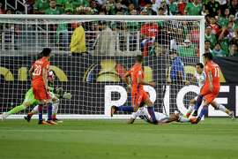 Chile's Eduardo Vargas, right, scores against Mexico during a Copa America Centenario quarterfinal soccer match at Levi's Stadium in Santa Clara, Calif., Saturday, June 18, 2016.