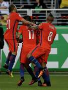 Chile's Eduardo Vargas, center. is congratulated by teammates after scoring his side's 2nd goal against Mexico during a Copa America Centenario quarterfinal soccer match at Levi's Stadium in Santa Clara, Calif., Saturday, June 18, 2016.