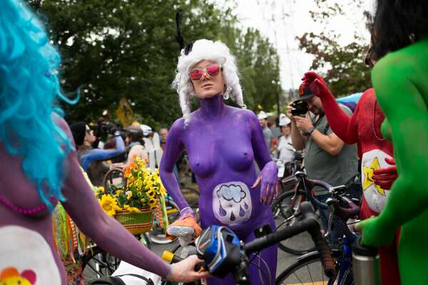 Naked teletubbies wait to ride before the Fremont Solstice Parade on Saturday June 18, 2016. (GRANT HINDSLEY, seattlepi.com)