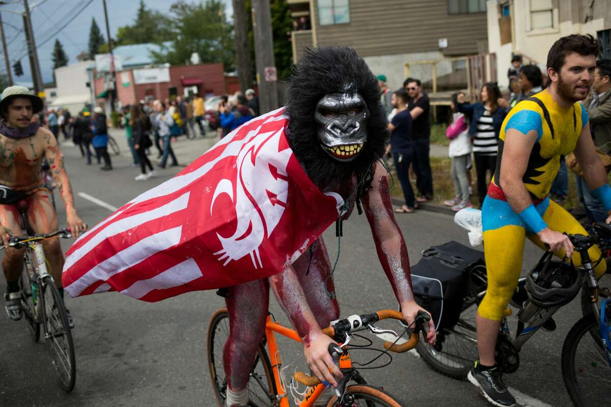 2016: Naked cyclists from Ballard join forces with those waiting to ride in the Fremont Solstice Parade on Saturday, June 18, 2016.