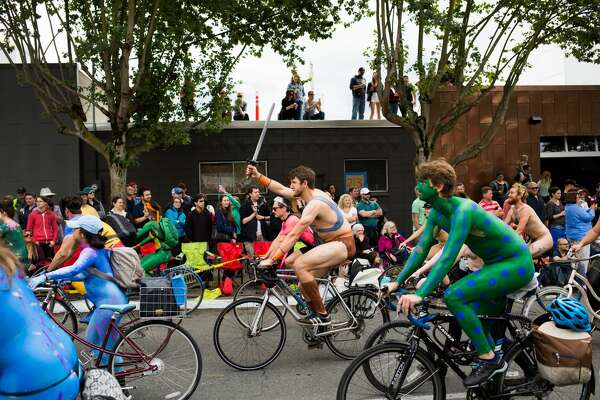 Naked cyclists take to the streets before the Fremont Solstice Parade on Saturday June 18, 2016. (GRANT HINDSLEY, seattlepi.com)