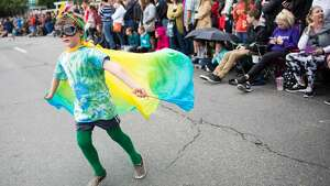 A young boy in a colorful cape goes back and forth greeting the crowd during the Fremont Solstice Parade on Saturday June 18, 2016. (GRANT HINDSLEY, seattlepi.com)