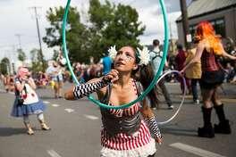 A hula-dancer twirls her hoop during the Fremont Solstice Parade on Saturday June 18, 2016. (GRANT HINDSLEY, seattlepi.com)