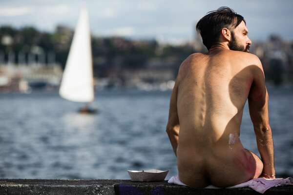 T.J. Murphy sits at Gas Works Park after taking a dip in Lake Union to wash off his body paint following the Fremont Solstice Parade proceeds on Saturday June 18, 2016. (GRANT HINDSLEY, seattlepi.com)