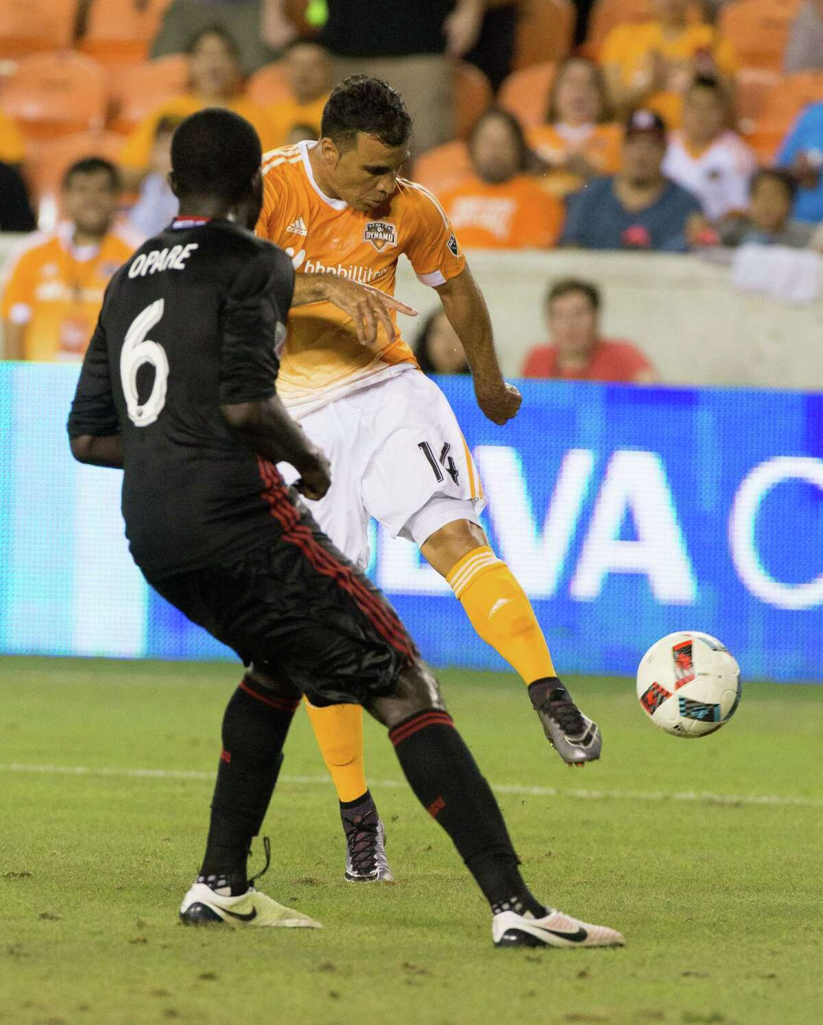 Houston Dynamo midfielder Alex (14) comes up short from kicking a goal in front of D.C. United defender Kofi Opare (6) during the second half of action between the Houston Dynamo and the D.C. United during a soccer game at BBVA Compass, Saturday, June 18, 2016, in Houston. Houston Dynamo tied D.C. United 0-0. ( Juan DeLeon / for the Houston Chronicle )