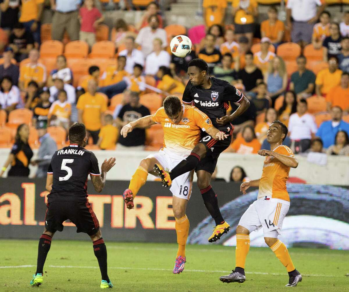 D.C. United forward Fabian Espindola (10) leaps over Houston Dynamo defender David Horst (18) to head but the ball during the second half of action between the Houston Dynamo and the D.C. United during a soccer game at BBVA Compass, Saturday, June 18, 2016, in Houston. Houston Dynamo tied D.C. United 0-0. ( Juan DeLeon / for the Houston Chronicle )