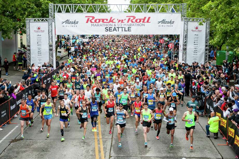 The first wave of marathon runners run through the starting gate at the Rock 'n' Roll Marathon in downtown Seattle on June 18, 2016. Photo: LACEY YOUNG, SEATTLEPI.COM / Other