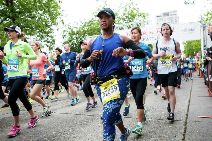 Runners run along Broad Street.