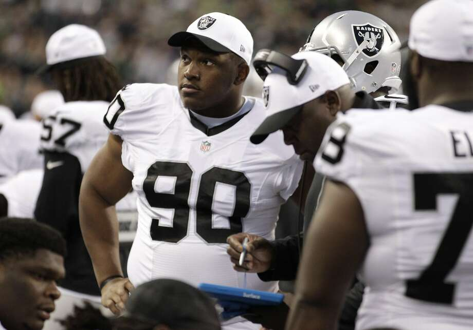 Oakland Raiders defensive tackle Dan Williams (90) stands on the sideline in the first half of a preseason NFL football game against the Seattle Seahawks, Thursday, Sept. 3, 2015, in Seattle. (AP Photo/Stephen Brashear) Photo: Stephen Brashear, Associated Press
