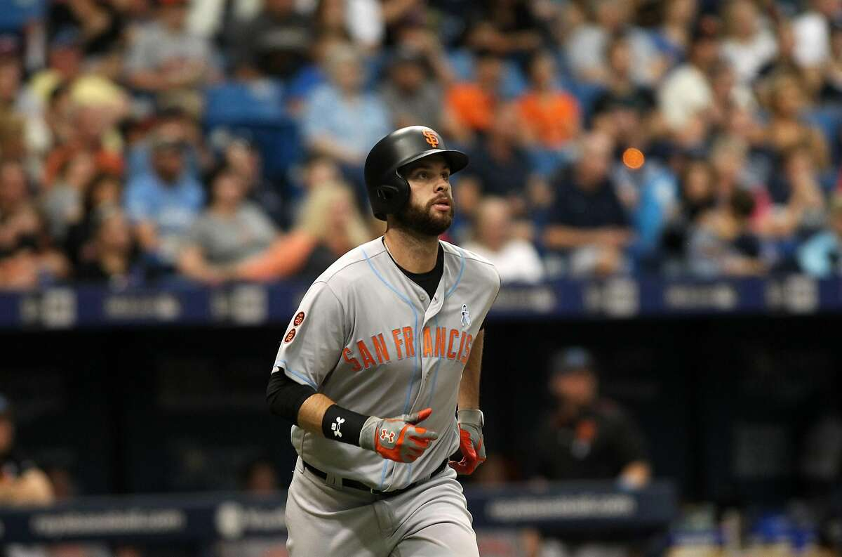 ST. PETERSBURG, FL - JUNE 19: Brandon Belt #9 of the San Francisco Giants watches the path of his ball after hitting a home run to right field off of pitcher Jake Odorizzi of the Tampa Bay Rays during the fourth inning of a game on June 19, 2016 at Tropicana Field in St. Petersburg, Florida. (Photo by Brian Blanco/Getty Images)