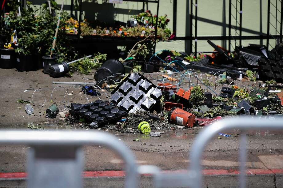 Debris can be seen on the sidewalk after a five-alarm fire tore through a building yesterday near the corner of Mission St. and 29th St in San Francisco, California, on Sunday, June 19, 2016. Photo: Gabrielle Lurie, Special To The Chronicle