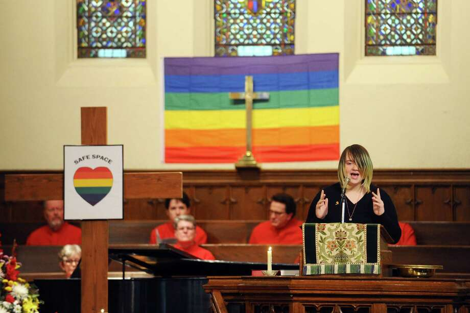 Sun Kinsey reads an original poem during the First Congregational Church of Stamford's pride service on Sunday, June 19, 2016. Photo: Michael Cummo / Hearst Connecticut Media / Stamford Advocate