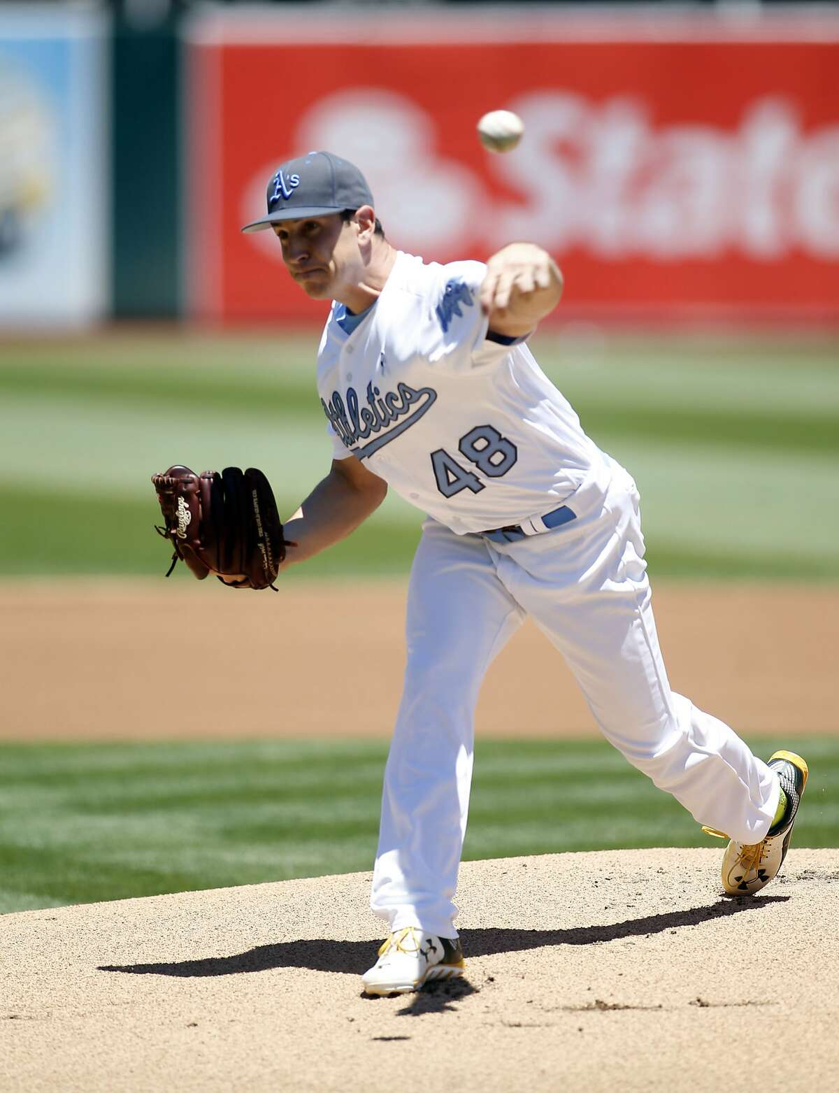Oakland Athletics starting pitcher Eric Surkamp delivers against the Los Angeles Angels during the first inning of a baseball game Sunday, June 19, 2016, in Oakland, Calif. (AP Photo/D. Ross Cameron)