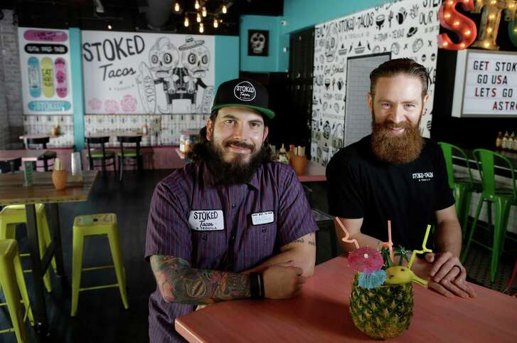Owners Adam Puskoriusm, left, and Keith Doyle, right, pose in Stoked Tacos & Tequila, 2416 Brazos, Wednesday, June 15, 2016, in Houston.