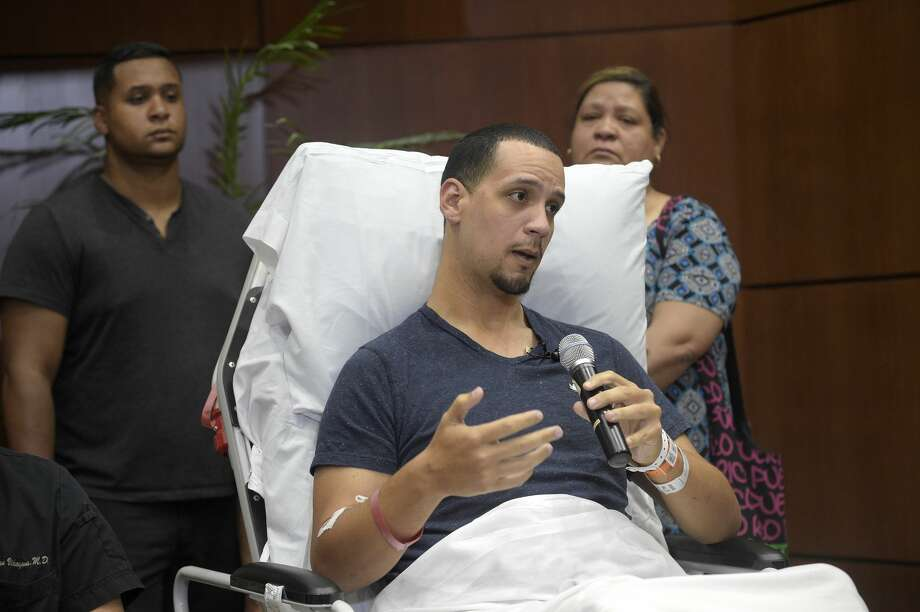 Angel Santiago, a victim of the Pulse nightclub shooting, center, speaks during a news conference at Florida Hospital Orlando Tuesday, June 14, 2016, in Orlando, Fla. Behind him are his brother, Samuel Santiago, left, and mother Gloria Santiago. (AP Photo/Phelan M. Ebenhack) Photo: Phelan M. Ebenhack/AP