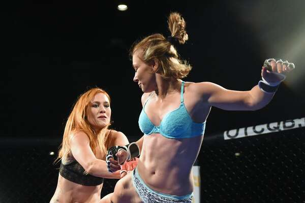 """NICE, CA - JUNE 18:  Fighters Jolene """"The Valkyrie"""" Hexx (L) and Andreea """"The Storm"""" Vladoi compete during """"Lingerie Fighting Championships 21: Naughty 'n Nice"""" at the Robinson Rancheria Resort & Casino on June 18, 2016 in Nice, California. The bout ended in a draw.  (Photo by Ethan Miller/Getty Images for LFC)"""