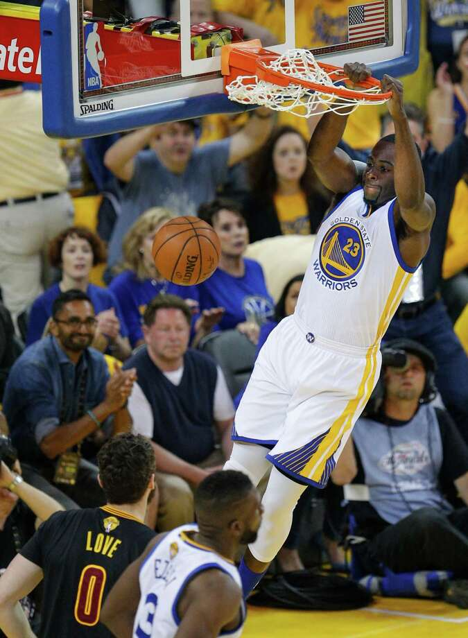 Golden State Warriors' Draymond Green goes up for a dunk in the first quarter during Game 7 of the NBA Finals at Oracle Arena on Sunday, June 19, 2016 in Oakland, Calif. Photo: Michael Macor, The Chronicle / online_yes